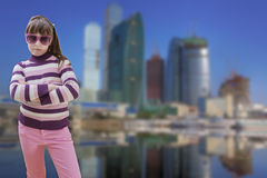 Teenage girl in pink wears sunglasses with modern Royalty Free Stock Image