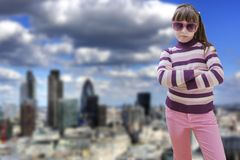 Teenage girl in pink wears sunglasses with modern Stock Images