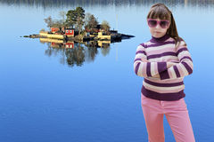 Teenage girl in pink wears sunglasses and sea island in backgrou Royalty Free Stock Photography