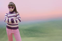 Teenage girl in pink wears sunglasses at sunrise Royalty Free Stock Images