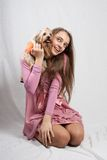 Teenage girl in pink with yorkie Royalty Free Stock Photos