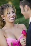 Teenage girl pinning boutonni�re on date Stock Photography