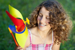Teenage Girl With Pinwheel Stock Photo
