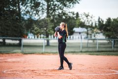 Teenage girl in pitching stance royalty free stock images