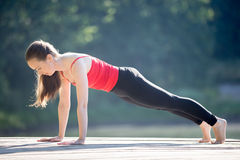 Teenage girl in plank pose Stock Photography