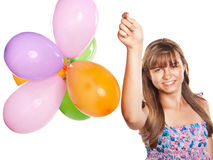 Teenage girl playing with balloons Stock Images