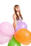 Teenage girl playing with balloons Royalty Free Stock Photos