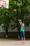 Teenage girl playing basketball Royalty Free Stock Images