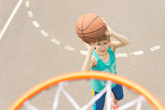 Teenage girl playing basketball Royalty Free Stock Photos
