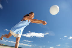 Teenage girl playing beach volleyball Royalty Free Stock Photos