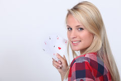 Teenage girl with playing cards Stock Photos