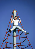 Teenage girl playing on child playground Stock Photos