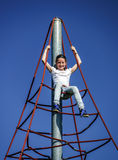 Teenage girl playing on child playground Stock Photo