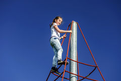 Teenage girl playing on child playground Royalty Free Stock Photography