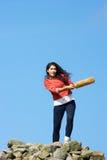 Teenage Girl Playing Cricket Outdoors Stock Photo