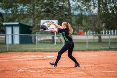 Teenage girl playing fastball Stock Photography
