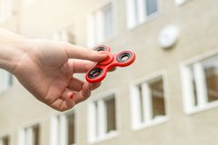 Teenage girl playing with fidget spinner. At recess or break in school yard Royalty Free Stock Photos