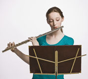 Teenage girl playing flute Royalty Free Stock Photo