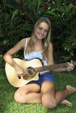 Teenage girl playing guitar Royalty Free Stock Photo