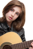 Teenage girl playing guitar Royalty Free Stock Photo