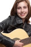 Teenage girl playing guitar Royalty Free Stock Images