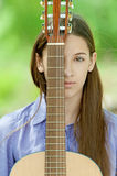 Teenage girl playing guitar Royalty Free Stock Image