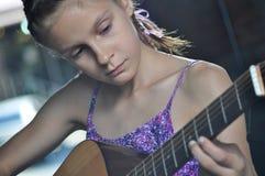 Teenage girl playing guitar Royalty Free Stock Photography