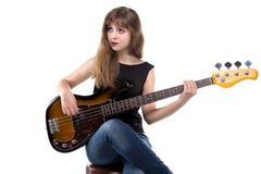 Teenage girl playing on guitar Stock Image