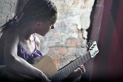 Teenage girl playing guitar Royalty Free Stock Photos