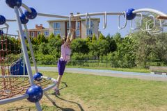 Little beginner school girl playing at playground royalty free stock images