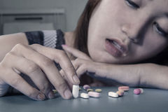 Teenage girl playing pills Stock Image