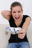 Teenage girl playing playstation. And screaming royalty free stock photography