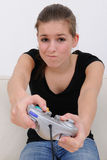 Teenage girl playing playstation. And loosing the game royalty free stock image