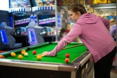 Teenage girl playing pool stock photo