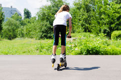 Teenage girl playing on a scooter Stock Photography