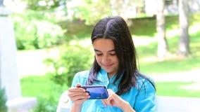 Teenage girl playing on smart phone stock video