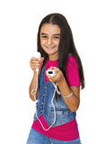 Teenage girl playing video games. A teenage girl playing video game, isolated on white background stock photo