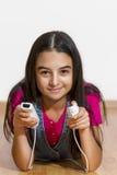 Teenage girl playing video games Royalty Free Stock Image