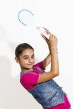 Teenage girl playing video games Royalty Free Stock Photo