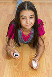Teenage girl playing video games Royalty Free Stock Image