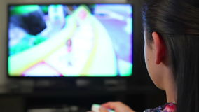 Teenage girl playing video games on smart TV stock video