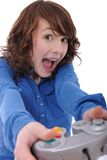 Teenage girl playing videogame. Cute teenage girl playing videogame and having fun screaming Royalty Free Stock Images