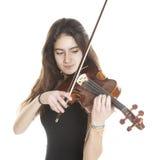 Teenage girl plays violin in studio Royalty Free Stock Photos