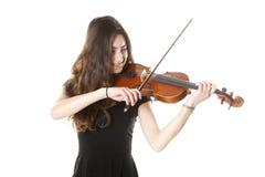 Teenage girl plays violin in studio stock images