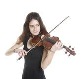 Teenage girl plays violin in studio Stock Photos