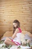 Teenage Girl  with plush bear Stock Photo