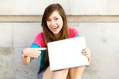 Teenage girl pointing finger Royalty Free Stock Images