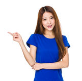 Teenage girl pointing finger up. Isolated on white background stock photo