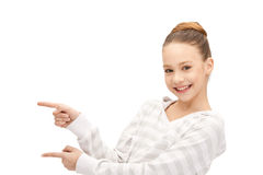 Teenage girl pointing her finger Stock Images