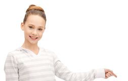 Teenage girl pointing her finger Royalty Free Stock Photos